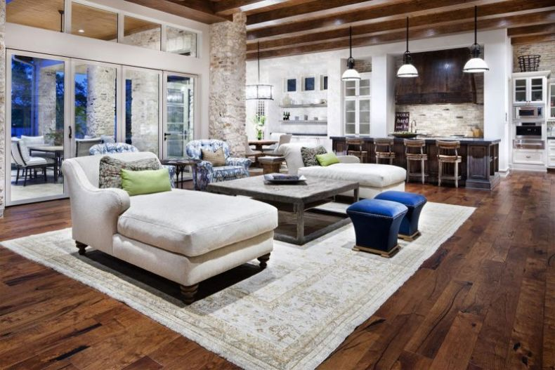 breathtaking-design-open-plan-kitchen-living-room-ideas-white-color-sofa-white-chaise-floral-pattern-classic-rug-square-shape-coffee-table-with-shelf-dark-brown-wooden-kitchen-cabinets-brown-wooden-fl