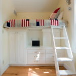 placing-the-bed-above-the-storage-for-small-bedroom-design-in-white-color-scheme