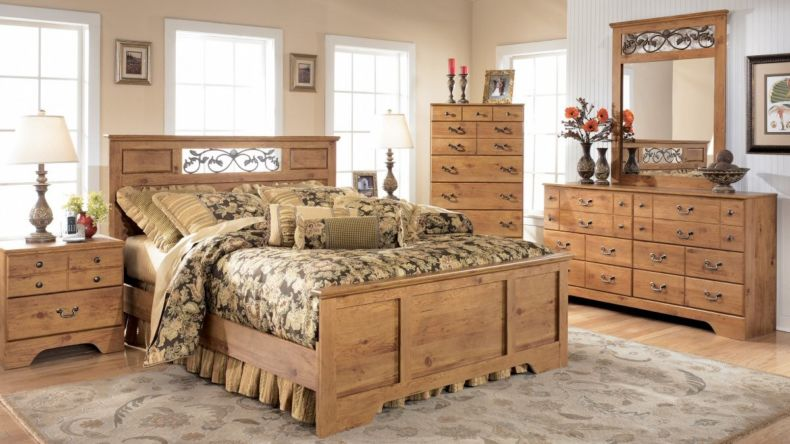 comfortable-dark-floral-bedding-set-and-rustic-bedroom-furniture-design-plus-tall-windows-idea