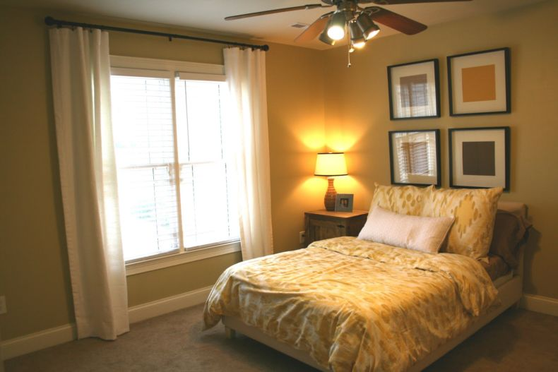 cool-bedroom-flush-mounted-ceiling-fan-above-yellow-floral-bedding-set-near-white-window-curtains