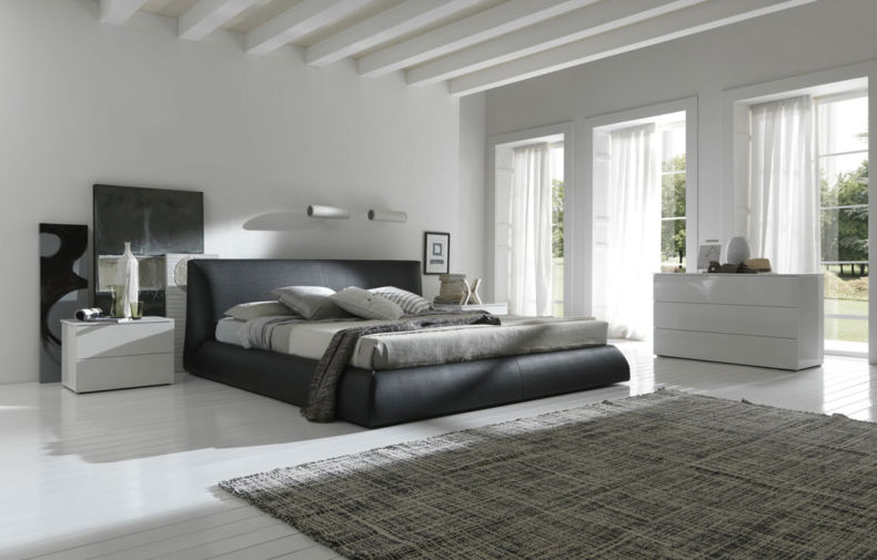 white-bedroom-with-black-bed-white-furniture-big-windows-clean-and-big-shinny-room