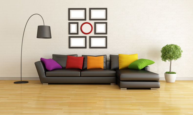 brilliant-colorful-pillows-implemented-in-dark-sectional-sofa-next-to-black-standing-lamps-for-living-room-also-in-front-of-dark-grey-wall-ornaments-with-square-and-red-circle-shape-1208x724
