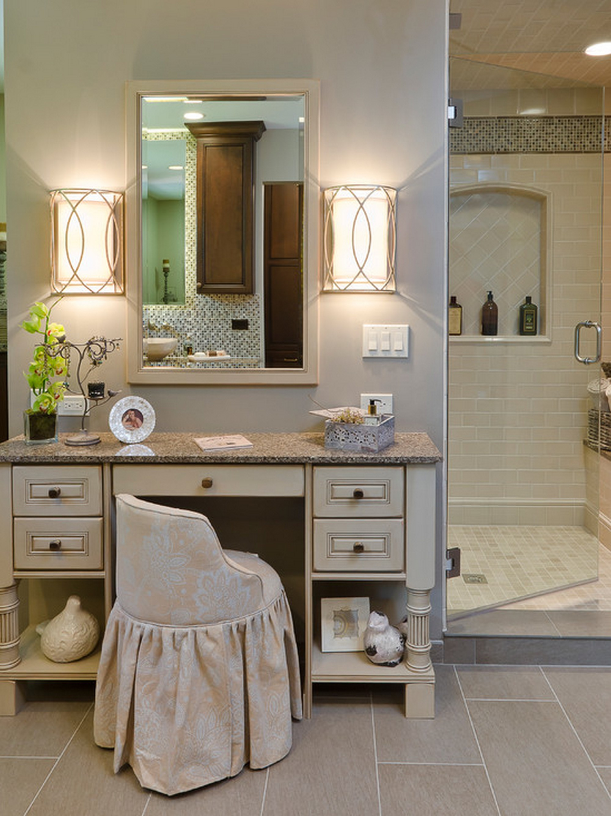 dressing-table-with-mirror-in-bathroom-furnished-with-wall-sconce-lightings-and-completed-with-chair