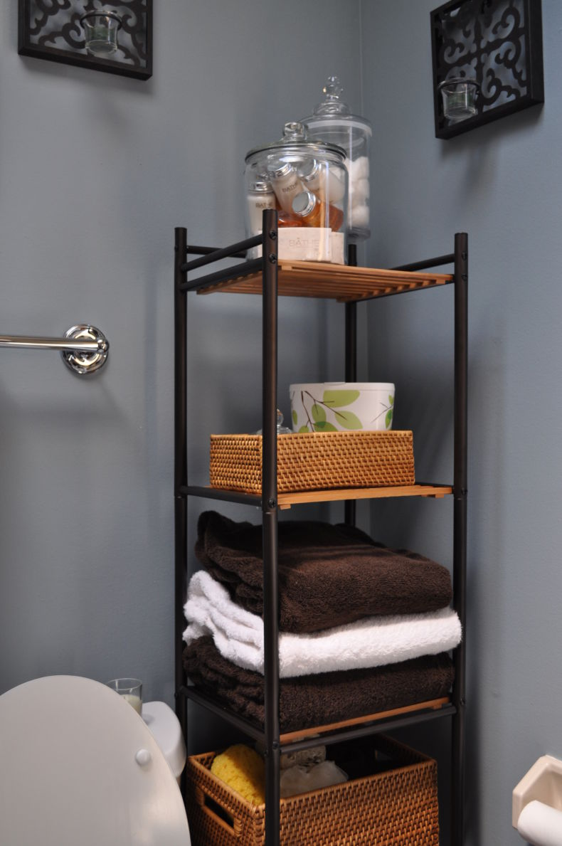 lovely-dark-bathroom-shelving-units-with-three-shelf-for-towels-and-bathroom-accessories-also-wicker-basket