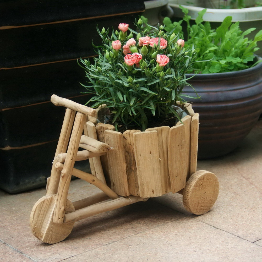 mesmeric-garden-with-stylish-decor-of-creative-flower-pots-made-of-wooden-material-in-bicycle-shape-design-with-wide-basket-to-plants-rose