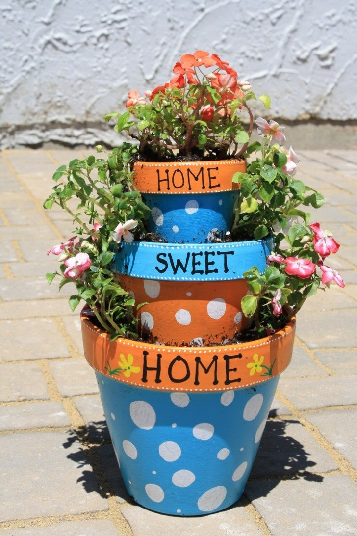 decoration-ideas-fetching-image-of-decorative-stacked-round-colorful-painted-polka-dot-pattern-front-porch-flower-pots-as-accessories-for-front-porch-decorating-design-ideas-entrancing-front-porch-de