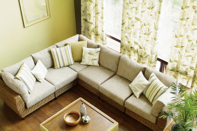 living-room-with-l-shape-sofa-also-floral-curtain-and-beautiful-plant